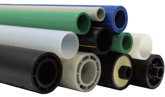 Plastic valves and piping systems